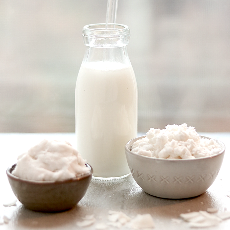 a bottle of homemade coconut milk with homemade coconut cream and homemade coconut flour